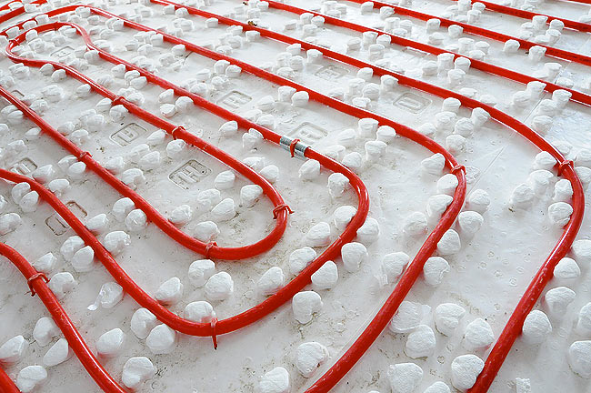 Closeup on Rautherm underfloor heating pipe installed in Amadeo II