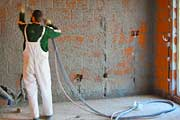 Finishing the interior walls with cement plaster